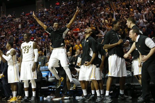 Members of the Virginia Commonwealth bench react after a basket while playing Stephen F. Austin during the second half of a second-round game in the NCAA college basketball tournament Friday, March 21, 2014, in San Diego. (AP Photo/Lenny Ignelzi)