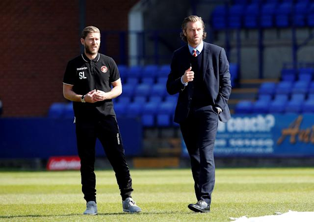 "Soccer Football - National League Play-Off Semi Final - Tranmere Rovers vs Ebbsfleet United - Prenton Park, Birkenhead, Britain - May 5, 2018 Ebbsfleet United Manager Daryl McMahon (R) takes a walk around the pitch ahead of the match Action Images/Craig Brough EDITORIAL USE ONLY. No use with unauthorized audio, video, data, fixture lists, club/league logos or ""live"" services. Online in-match use limited to 75 images, no video emulation. No use in betting, games or single club/league/player publications. Please contact your account representative for further details."