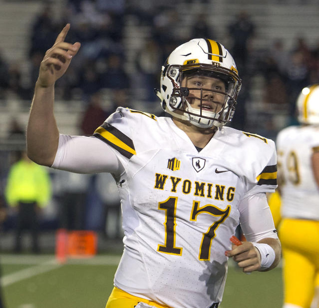 FILE - In this Oct. 22, 2016, file photo, Wyoming quarterback Josh Allen reacts after scoring a touchdown in the second half of an NCAA college football game against Nevada in Reno, Nev. Allen is expected to be a first round pick in the NFL Draft. (AP Photo/Tom R. Smedes, File)