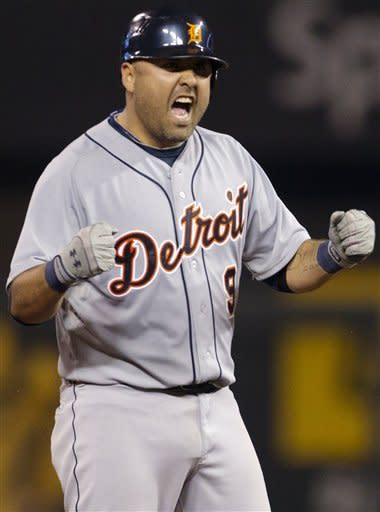Detroit Tigers' Gerald Laird (9) celebrates his three-run double during the sixth inning of a baseball game against the Kansas City Royals at Kauffman Stadium in Kansas City, Mo., Monday, Oct. 1, 2012. (AP Photo/Orlin Wagner)