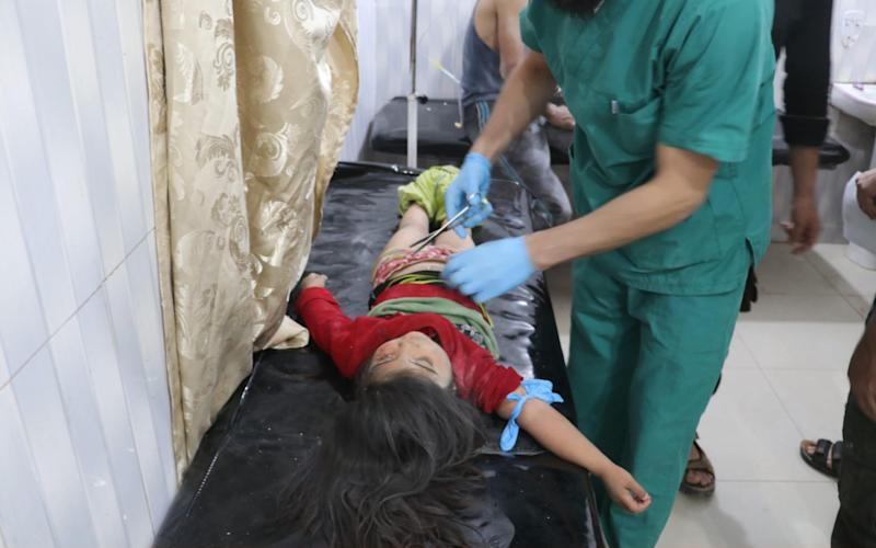 A child wounded in airstrikes is treated at an Idlib region hospital in May. - Anadolu