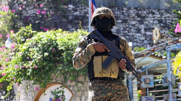 PHOTO:A Haitian police officer stands guard outside of the presidential residence, July 7, 2021, in Port-au-Prince, Haiti. (Valerie Baeriswyl/AFP via Getty Images)