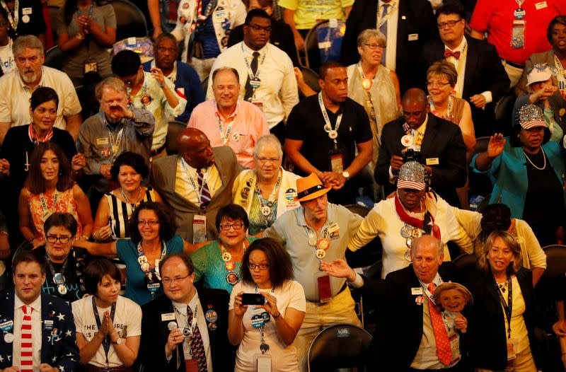 "FILE PHOTO: Delegates sway to musician Carole King's performance of ""You've Got a Friend"" at the Democratic National Convention in Philadelphia, Pennsylvania"
