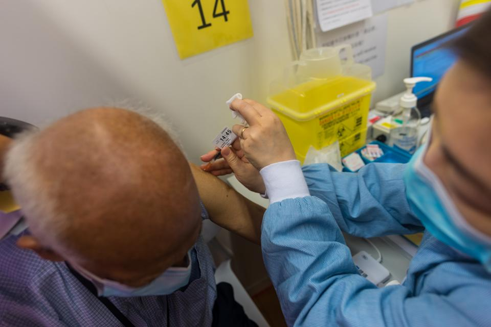 An 84-year old resident receives his second Pfizer-Biontech dose of vaccine at the Hiu Kwong vaccination center  in Hong Kong, China, on 7 Apr 2021. Originally scheduled for April 1st, his shot was rebooked to April 7th, after Hong Kong said they found packaging issues with the batches used for the first shot. After a suspension due to concerns around the packaging of batches of Pfizer-Biontech vaccines, Hong Kong resumed its vaccination program for this jab. The bookings for first and second dose far outpaced the Chinese Coronavac vaccine, beset by concerns over its safety after several deaths with cardiovascular issues happened in patients days or weeks after the jabs. The authorities have said the deaths were not linked to the Chinese vaccines. Uptake for the Pfizer-Biontech vaccine has been higher at about 15,000 bookings per day.  (Photo by Marc Fernandes/NurPhoto via Getty Images)