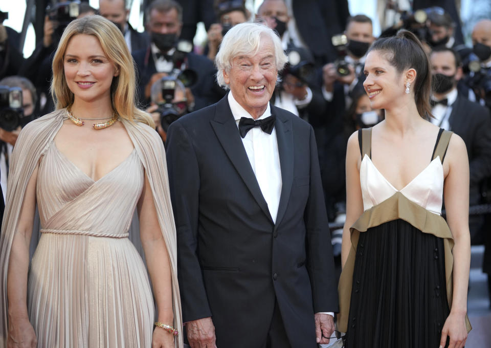 Virginie Efira, from left, director Paul Verhoeven, and Daphne Patakia pose for photographers upon arrival at the premiere of the film 'Benedetta' at the 74th international film festival, Cannes, southern France, Friday, July 9, 2021. (AP Photo/Vadim Ghirda)
