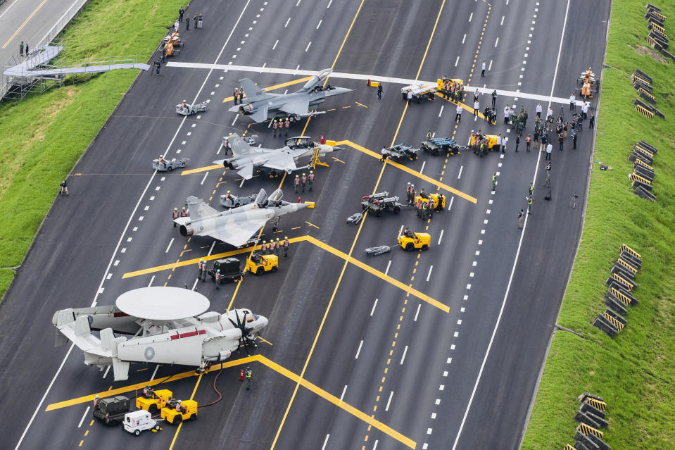 FILE - In this file photo released by Taiwan's Military News Agency, Taiwan war planes are parked on a highway during an exercise to simulate a response to a Chinese attack on its airfields in Changhua in southern Taiwan. Taiwan said Tuesday, Oct 27, 2020, that recent proposed of U.S. sales of missiles and other arms systems will boost the island's ability to credibly defend itself, amid rising threats from China. (Military News Agency via AP, File)