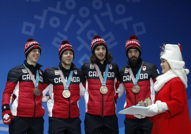Medals Ceremony - Short Track Speed Skating Events - Pyeongchang 2018 Winter Olympics - Men's 5000m Relay - Medals Plaza - Pyeongchang, South Korea - February 23, 2018 - Bronze medalists Samuel Girard, Charles Hamelin, Charle Cournoyer and Pascal Dion of Canada on the podium. REUTERS/Eric Gaillard