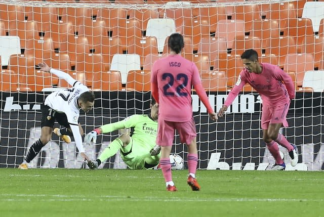 Raphael Varane, right, scored an own-goal in Real Madrid's defeat at Valencia