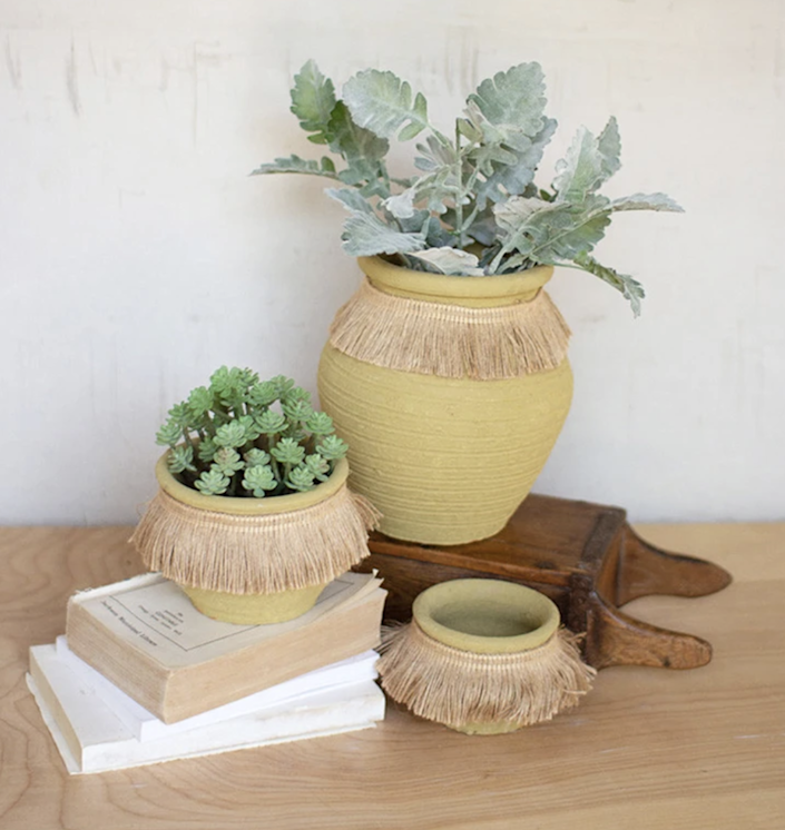 """It's all about the jute details in this set of three. $59, Jungalow. <a href=""""https://www.jungalow.com/collections/planter-sets/products/set-of-jute-clay-pots"""" rel=""""nofollow noopener"""" target=""""_blank"""" data-ylk=""""slk:Get it now!"""" class=""""link rapid-noclick-resp"""">Get it now!</a>"""