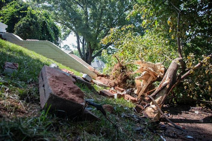 Two people died and two others injured during a wreck in Charlotte's Eastover neighborhood early Sunday, police said. The vehicle hit the curb on Colville Road, then veered into brick steps and a tree, shown on Monday, August 2, 2021.