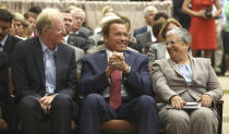 FILE - In this Sept. 8, 2014, file photo, former California Gov. Arnold Schwarzenegger, center, talks with actor Ed Begley Jr. and Mary Nichols, chair of the California Air Resources Board, in Sacramento, Calif. Nichols' term leading the board ends in December. She's held the role since 2007 after an earlier stint as chair in the early 1980's. (AP Photo/Rich Pedroncelli, File)