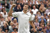 Poland's Hubert Huekacz celebrates after defeating Russia's Daniil Medvedev during the men's singles fourth round match on day eight of the Wimbledon Tennis Championships in London, Tuesday, July 6, 2021. (AP Photo/Kirsty Wigglesworth)