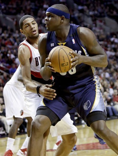 Memphis Grizzlies forward Zach Randolph, right, looks for an opening to the basket against Portland Trail Blazers forward Nicolas Batum, from France, during the first quarter of an NBA basketball game in Portland, Ore., Tuesday, March 12, 2013. (AP Photo/Don Ryan)