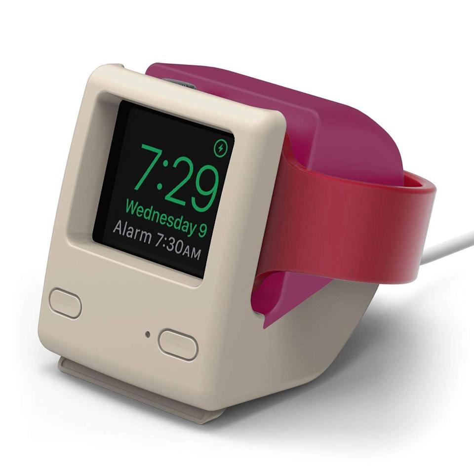 """<h3><a href=""""https://amzn.to/2RbJOxY"""" rel=""""nofollow noopener"""" target=""""_blank"""" data-ylk=""""slk:Apple Watch Mac-Monitor Charging Stand"""" class=""""link rapid-noclick-resp"""">Apple Watch Mac-Monitor Charging Stand</a></h3><br>This little charging stand transforms a resting Apple Watch into a retro Mac monitor — and now no tech accessory will ever be as cute. <br><br><strong>elago</strong> W4 Apple Watch Stand, $, available at <a href=""""https://amzn.to/2RbJOxY"""" rel=""""nofollow noopener"""" target=""""_blank"""" data-ylk=""""slk:Amazon"""" class=""""link rapid-noclick-resp"""">Amazon</a>"""
