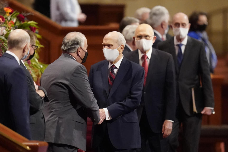 The Church of Jesus Christ of Latter-day Saints President Russell M. Nelson, center, is greeted as he arrives during The Church of Jesus Christ of Latter-day Saints' twice-annual church conference Saturday, Oct. 2, 2021, in Salt Lake City. (AP Photo/Rick Bowmer)