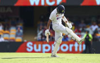 India's Cheteshwar Pujara reacts in frustration after he was dismissed during play on the final day of the fourth cricket test between India and Australia at the Gabba, Brisbane, Australia, Tuesday, Jan. 19, 2021. (AP Photo/Tertius Pickard)