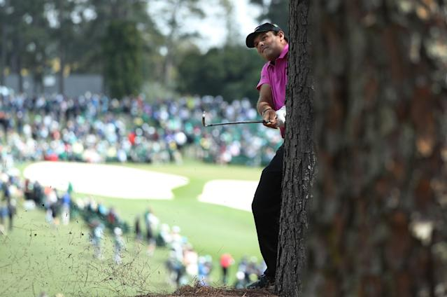 Patrick Reed of the U.S. hits his second shot on the first hole from next to a tree during final round play of the 2018 Masters golf tournament at the Augusta National Golf Club in Augusta, Georgia, U.S. April 8, 2018. REUTERS/Lucy Nicholson