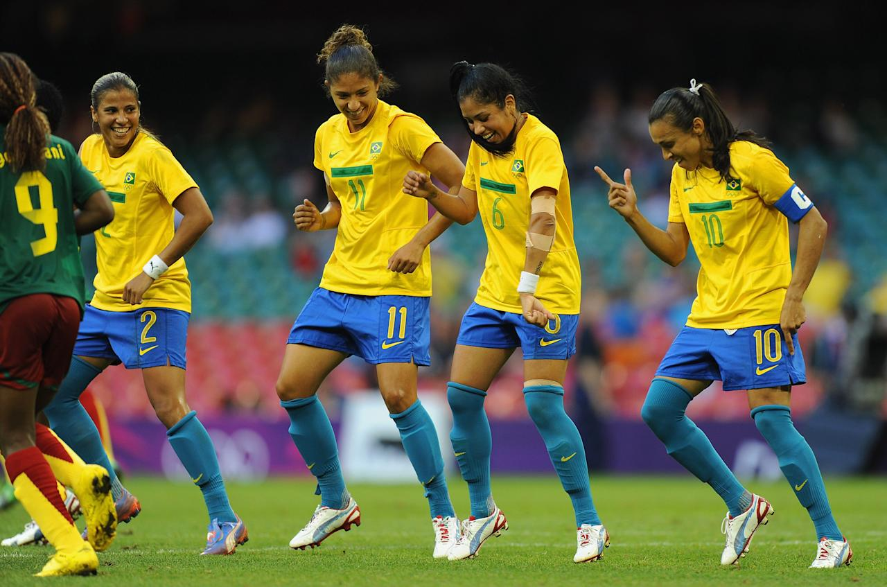 CARDIFF, WALES - JULY 25:  Fabiana, Cristiane and Maurine of Brazil celebrate with team mate Marta after her goal to make it 4-0 during the First Round Women's Football Group E Match of the London 2012 Olympic Games between Cameroon and Brazil at Millennium Stadium on July 25, 2012 in Cardiff, Wales.  (Photo by Michael Regan/Getty Images)