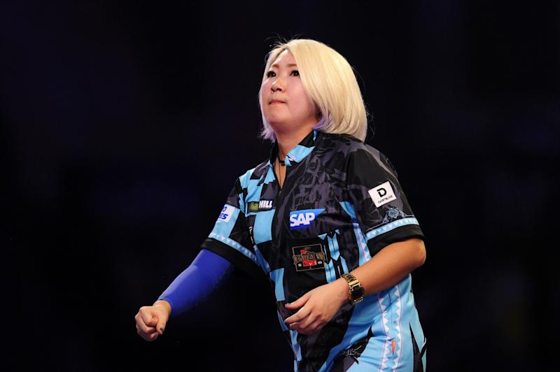LONDON, ENGLAND - DECEMBER 15: Mikuru Suzuki of Japan celebrates in her First Round match against James Richardson of England during Day Three of the 2020 William Hill World Darts Championship at Alexandra Palace on December 15, 2019 in London, England. (Photo by Alex Burstow/Getty Images)