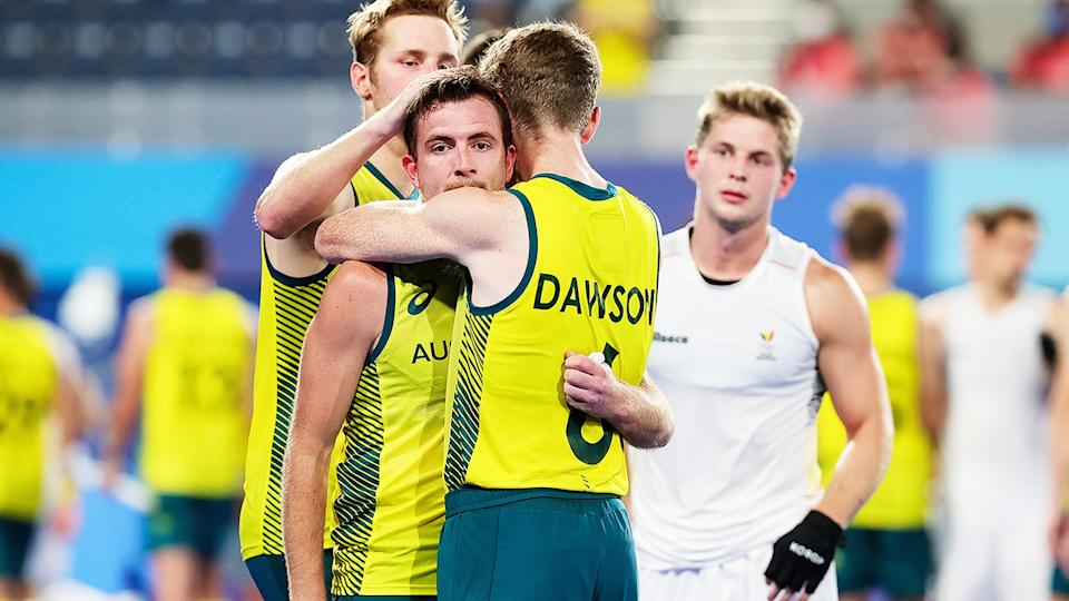 Jacob Whetton and Matthew Dawson, pictured here consoling each other after the Hockeyroos' loss to Belgium.
