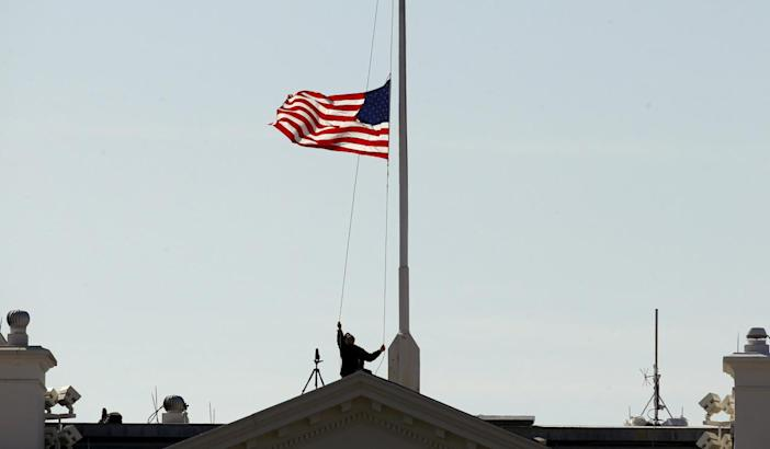The flag is lowered to half-staffover the White House