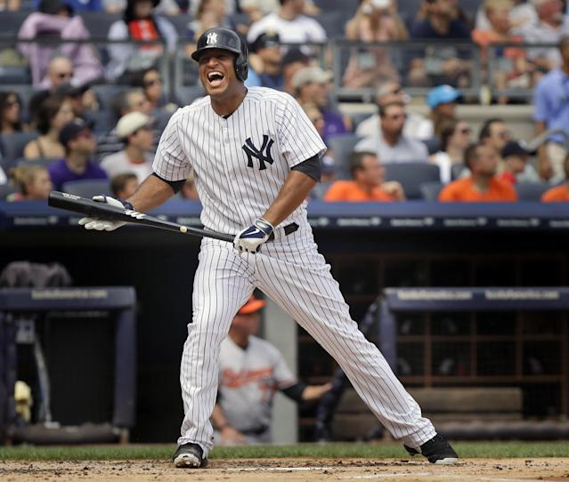 New York Yankees' Vernon Wells reacts after fouling off a pitch during the first inning of the baseball game against the Baltimore Orioles at Yankee Stadium Sunday, Sept. 1, 2013 in New York. (AP Photo/Seth Wenig)