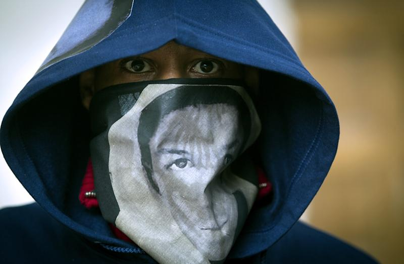 "A man wears a hoodie and a scarf with the likeness of Trayvon Martin during a ""One Thousand Hoodies March for Trayvon Martin"" event Thursday, March 29, 2012 at the University of Minnesota campus in Minneapolis. Martin, a Florida teenager, was wearing a hoodie when he was shot and killed by a neighborhood watch volunteer. (AP Photo/The Star Tribune, Renee Jones Schneider)  MANDATORY CREDIT; ST. PAUL PIONEER PRESS OUT; MAGS OUT; TWIN CITIES TV OUT"