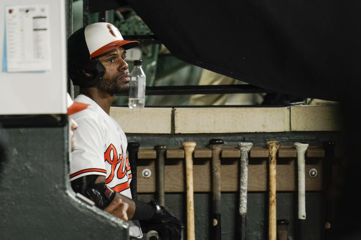 Baltimore Orioles' Cedric Mullins looks on from the dugout during the ninth inning of a baseball game against the New York Yankees, Tuesday, Sept. 14, 2021, in Baltimore. (AP Photo/Julio Cortez)