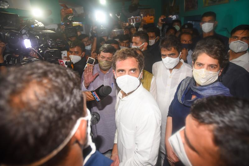 HATHRAS, INDIA - OCTOBER 3, 2020: Congress leader Rahul Gandhi and AICC General Secretary Priyanka Gandhi leave after meeting with relatives of the woman allegedly gang-raped and killed in Bool Garh, on October 3, 2020 in Hathras, India. (Photo by Amal KS/Hindustan Times via Getty Images)