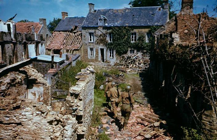 """""""We thought it was going to be murder but it wasn't. To show you how easy it was, I ate my bar of chocolate. In every other operational trip, I sweated so much the chocolate they gave us melted in my breast pocket."""" — Frank Scherschel describing his experiences photographing the Normandy invasion from the air, before he joined Allied troops heading inland. Above: GIs search ruined homes in western France after D-Day. (Frank Scherschel—Time & Life Pictures/Getty Images) <br> <br> <a href=""""http://life.time.com/history/d-day-rare-color-photos/#1"""" rel=""""nofollow noopener"""" target=""""_blank"""" data-ylk=""""slk:Click here"""" class=""""link rapid-noclick-resp"""">Click here</a> to see the full collection at LIFE.com"""