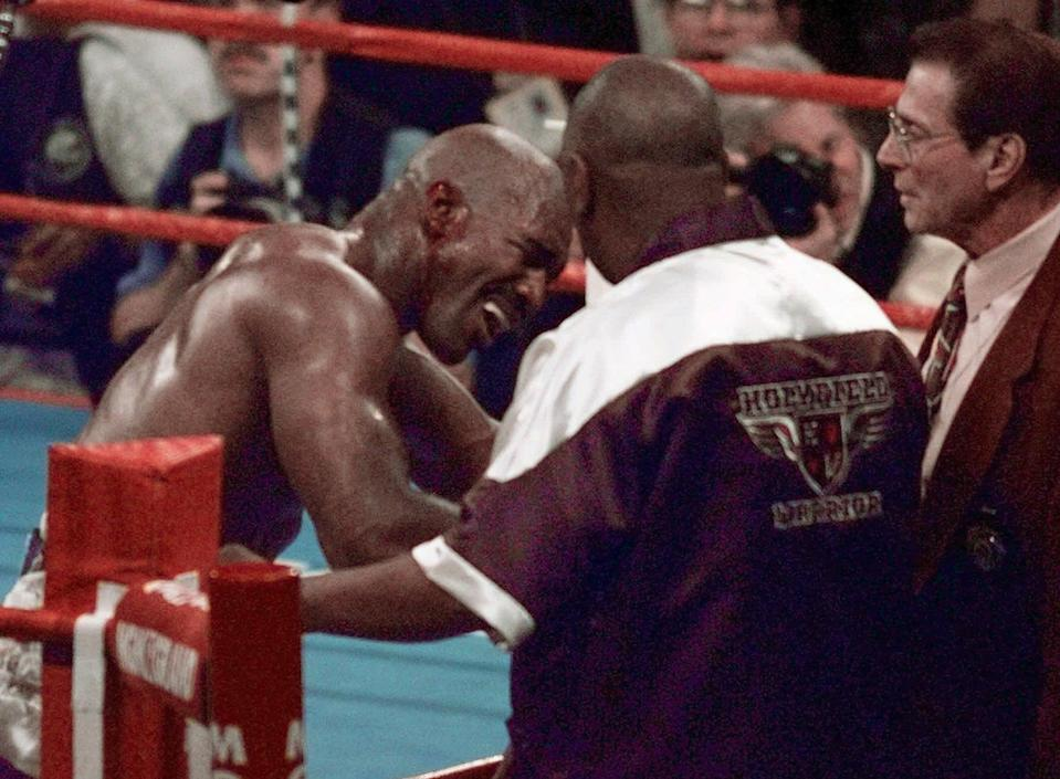<p>Evander Holyfield reacts after he was bit in the ear by Mike Tyson in the third round of their WBA Heavyweight match Saturday, June 28, 1997, at the MGM Grand in Las Vegas. (AP Photo/Jack Smith) </p>