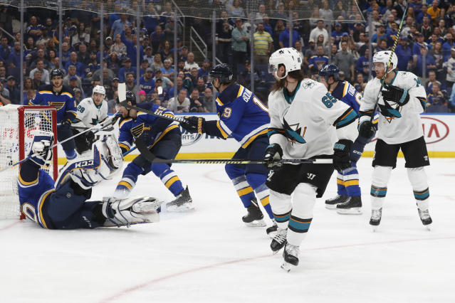 FILE - In this May 15, 2019, file photo, San Jose Sharks defenseman Erik Karlsson (65), of Sweden, scores the winning goal past St. Louis Blues goaltender Jordan Binnington (50) during overtime in Game 3 of the NHL hockey Stanley Cup Western Conference final series in St. Louis. A major officiating gaffe occurred in the Stanley Cup playoffs when San Joses Karlsson scored a goal set up by a hand pass. While hockey officials have the toughest job _ they must be able to skate like the players _ they do not get a pass for their mistakes, either. (AP Photo/Jeff Roberson, File)