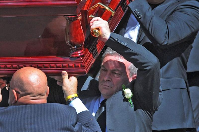 Borce Ristevski carries his wife's coffin at her funeral. Source: AAP