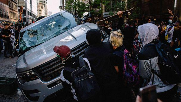 PHOTO: Protesters destroy a Chicago Police Vehicle, May 30, 2020, during a protest against the death of George Floyd. (Jim Vondruska/Zuma Press)