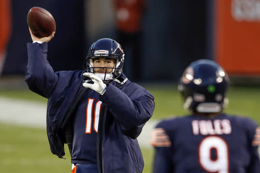 FILE - In this Nov. 1, 2020, file photo, Chicago Bears quarterback Mitchell Trubisky, left, warms up as he throws the ball to quarterback Nick Foles, right, during an NFL football game against the New Orleans Saints in Chicago. The college quarterbacks class is shaping up nicely, just in time to perhaps rescue some NFL teams from themselves. Those guys salivating about such prospects work in the personnel departments of the Jets, Jaguars and Bears. Maybe for the Lions, Patriots, Falcons, Saints and 49ers. (AP Photo/Kamil Krzaczynski, File)