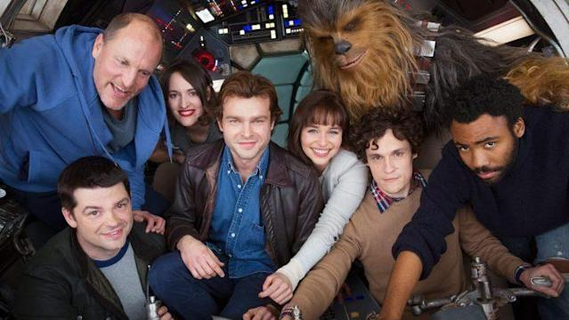 Chris Miller (black jacket) and Phil Lord (tan sweater) at the helm of the Falcon surrounded by the cast of the Han Solo movie (Credit: Twitter/Lucasfilm)