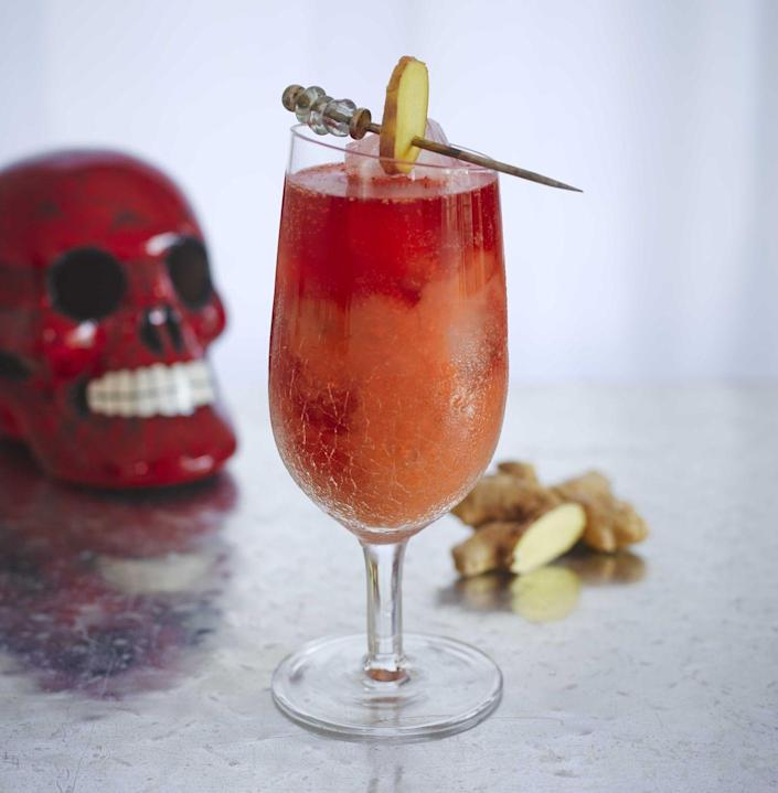 """<p><strong>Ingredients</strong></p><p>2 parts dark rum<br>1 part pumpkin puree<br>1 part Barrow's Intense Ginger Liqueur<br>1 Part Black Cherry Sparkling Ice<br>Grated ginger</p><p><strong>Instructions</strong></p><p>Shake puree, rum, ginger liqueur, and grated ginger over ice and pour into goblet. Add Black Cherry Sparkling Ice and garnish with ginger root """"tombstone.""""</p><p><a class=""""link rapid-noclick-resp"""" href=""""https://go.redirectingat.com?id=74968X1596630&url=https%3A%2F%2Fdrizly.com%2Fbarrows-intense-ginger-liqueur%2Fp6969%3Fis_autocomplete%3Dtrue&sref=https%3A%2F%2Fwww.townandcountrymag.com%2Fleisure%2Fdrinks%2Fg2839%2Fhalloween-drinks%2F"""" rel=""""nofollow noopener"""" target=""""_blank"""" data-ylk=""""slk:Buy Now"""">Buy Now</a> Barrow's Intense Ginger Liqueur, from $29.99<br></p>"""