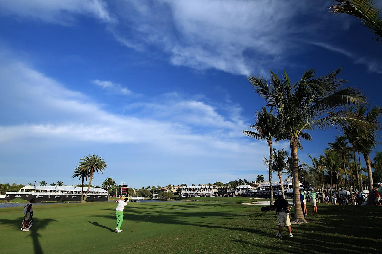 MIAMI, FL - MARCH 10:  Keegan Bradley of the USA plays his second shot at the par 4, 18th hole during the third round of the World Golf Championship Cadillac Championship on the TPC Blue Monster Course at Doral Golf Resort And Spa on March 10, 2012 in Miami, Florida.  (Photo by David Cannon/Getty Images)