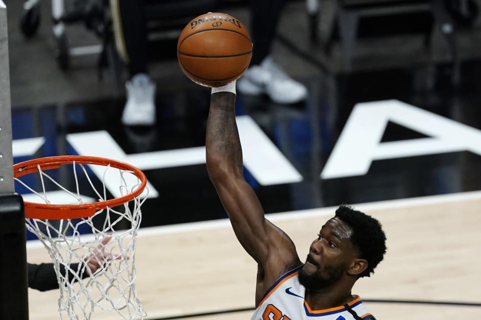 Phoenix Suns center Deandre Ayton (22) scores in the first half of an NBA basketball game against the Atlanta Hawks Wednesday, May 5, 2021, in Atlanta. (AP Photo/John Bazemore)