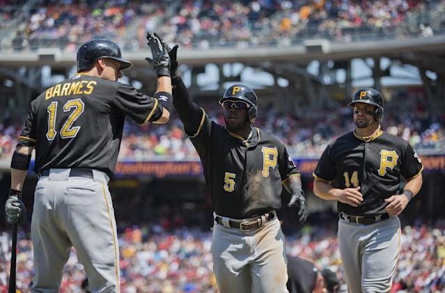 Pittsburgh Pirates Josh Harrison (5) is congratulated by teammates Clint Barmes (12) and Gaby Sanchez (14) after hitting a two-run home run during the sixth inning of a baseball game against the Washington Nationals at Nationals Park on Thursday, July 25, 2013, in Washington. (AP Photo/Evan Vucci)