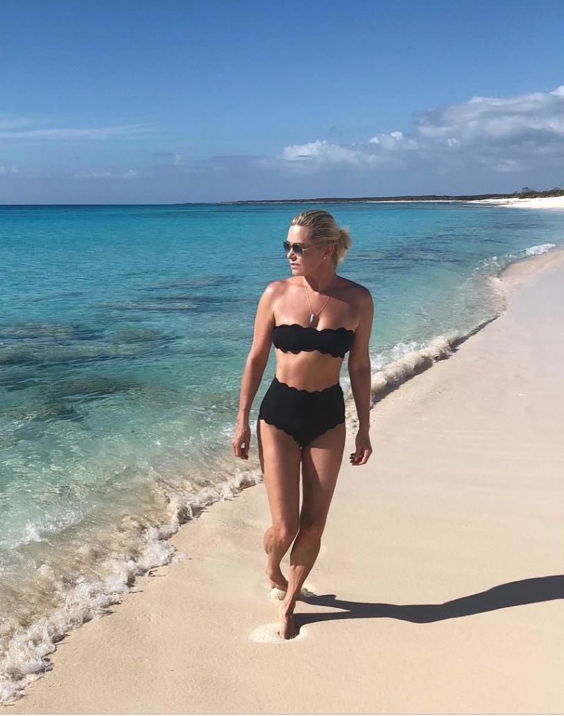 <p>Yolanda Hadid, 54, who is a model as well as mother to models Gigi, Bella, and Anwar, wears a scalloped black bikini top and high-waisted bottoms. (Photo: Instagram/Yolanda Hadid) </p>