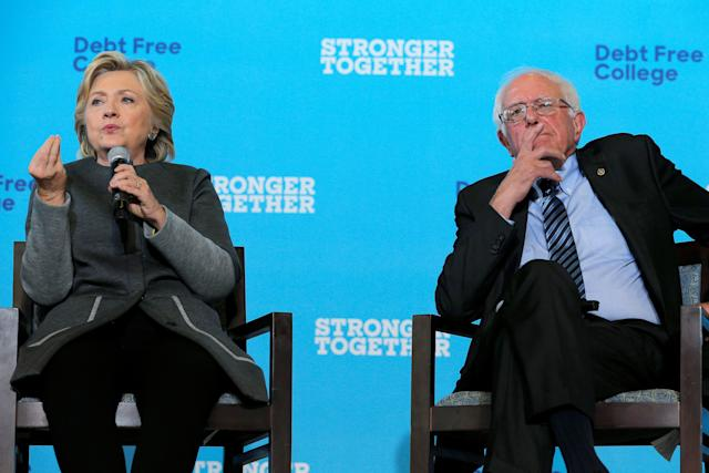 Former Democratic presidential candidates Hillary Clinton and Bernie Sanders appear ata campaign event in Durham, New Hampshire, onSept. 28, 2016.