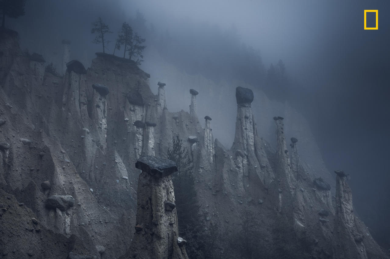 "<p>Photograph and caption by Marco Grassi/National Geographic Travel Photographer of the Year Contest. — ""These natural sand towers, capped with large stones, are known as the Earth Pyramids of Platten. They are situated in Northern Italy's South Tyrol region. Formed centuries ago after several storms and landslides, these land formations look like a landscape from outer space and continuously change over the years and, more accurately, over seasons. This natural phenomenon is the result of a continuous alternation between periods of torrential rain and drought, which have caused the erosion of the terrain and the formation of these pinnacles. As the seasons change, the temperatures move between extremes and storms affect the area, pyramids disappear over time, while new pinnacles form as well."" Brunico, South Tyrol, Italy. </p>"
