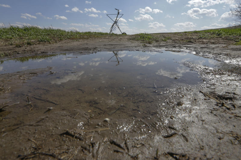 Rain water pools in a field near Sprague, Neb., Wednesday, April 24, 2013. Farmers who have spent the past several months staring at parched fields have a new problem: mud. A rainy spring has brought weeks of rains to the middle of the country, and while it hasn't completely ended the historic drought, new forecasts show it sure has helped. (AP Photo/Nati Harnik)