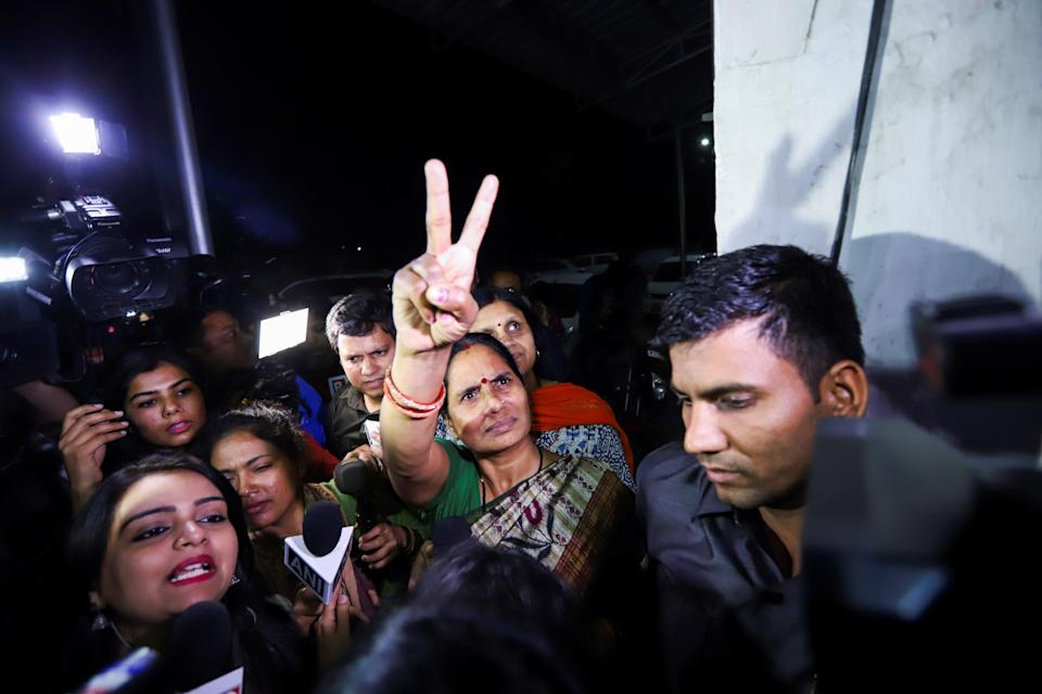 <p>Asha Devi, mother of 2012 gangrape victim, after four convicts were hanged in Delhi</p> (AFP via Getty Images)