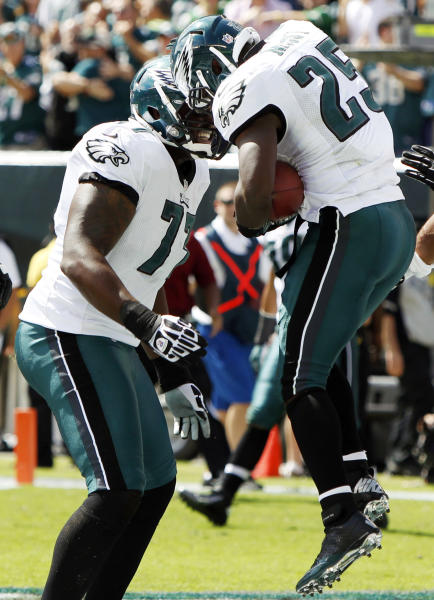 Philadelphia Eagles running back LeSean McCoy, right, and tackle Demetress Bell celebrate after McCoy's touchdown in the first half of an NFL football game against the Baltimore Ravens, Sunday, Sept. 16, 2012, in Philadelphia. (AP Photo/Mel Evans)