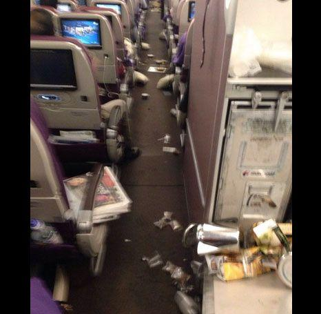 Belongings appear to have scattered down the aisle. Source: Twitter/ @LazyAviator
