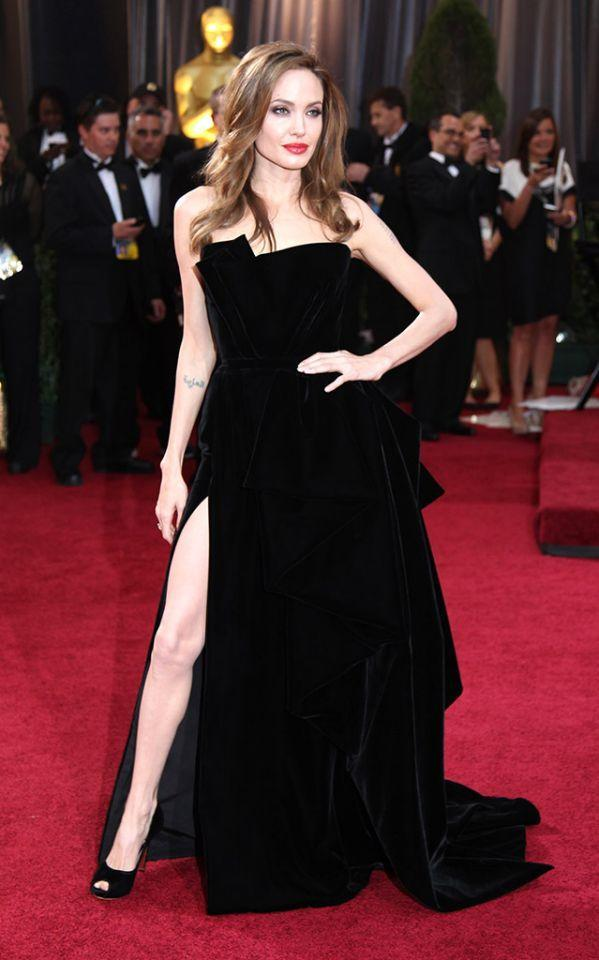 "<p>It's hard to top this iconic look the newly single mom of six opted for at the 2012 Oscars. ""Angie's Right Leg"" even got its own Twitter handle! For her part, Jolie, who showed her upper thigh, said she didn't know or care that a fuss was made over her kicky look. ""I didn't pay any attention,"" she sighed. (Photo: Getty Images) </p>"