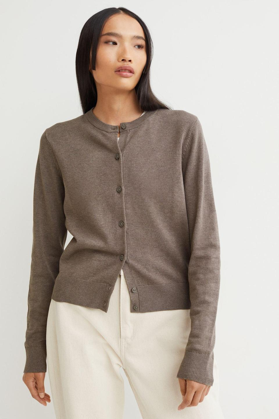 <p>You'll get a lot of wear out of this <span>Fine-knit Cardigan</span> ($11, originally $13) because you can wear it on its own, or layer it over a tank top. We liked it paired with cream pants for a nice visual contrast. </p>