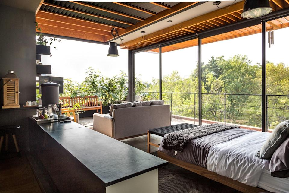 "<p>You'd think you could only find indoor-outdoor living on Mexico's coasts, but this rooftop Airbnb in Condesa proves that theory wrong. At under <a href=""https://www.cntraveler.com/gallery/what-a-dollar100-airbnb-looks-like-around-the-world?mbid=synd_yahoo_rss"" rel=""nofollow noopener"" target=""_blank"" data-ylk=""slk:$100 a night"" class=""link rapid-noclick-resp"">$100 a night</a>, it's also a steal. The loft space is essentially one room, with floor-to-ceiling sliding glass doors on two sides. Choose to spread out on the leafy terrace or living area, or stay put in bed for the best views. Note there isn't a full kitchen here—just a mini fridge—but in this neighborhood, you've got plenty of <em>Traveler</em>-approved <a href=""https://www.cntraveler.com/gallery/best-bars-in-mexico-city?mbid=synd_yahoo_rss"" rel=""nofollow noopener"" target=""_blank"" data-ylk=""slk:bars"" class=""link rapid-noclick-resp"">bars</a> and <a href=""https://www.cntraveler.com/gallery/best-restaurants-in-mexico-city?mbid=synd_yahoo_rss"" rel=""nofollow noopener"" target=""_blank"" data-ylk=""slk:restaurants"" class=""link rapid-noclick-resp"">restaurants</a> to choose from, like the mixology-serious <a href=""https://www.cntraveler.com/bars/mexico-city-df/baltra?mbid=synd_yahoo_rss"" rel=""nofollow noopener"" target=""_blank"" data-ylk=""slk:Baltra"" class=""link rapid-noclick-resp"">Baltra</a> or Oaxaca-centric <a href=""https://www.cntraveler.com/restaurants/mexico-city-df/pasillo-de-humo?mbid=synd_yahoo_rss"" rel=""nofollow noopener"" target=""_blank"" data-ylk=""slk:Pasillo de Humo"" class=""link rapid-noclick-resp"">Pasillo de Humo</a> in the nearby Mercado Parian food hall. </p> <p><strong>Book now:</strong> <a href=""https://airbnb.pvxt.net/AJYxD"" rel=""nofollow noopener"" target=""_blank"" data-ylk=""slk:From $95 per night, airbnb.com"" class=""link rapid-noclick-resp"">From $95 per night, airbnb.com</a></p>"